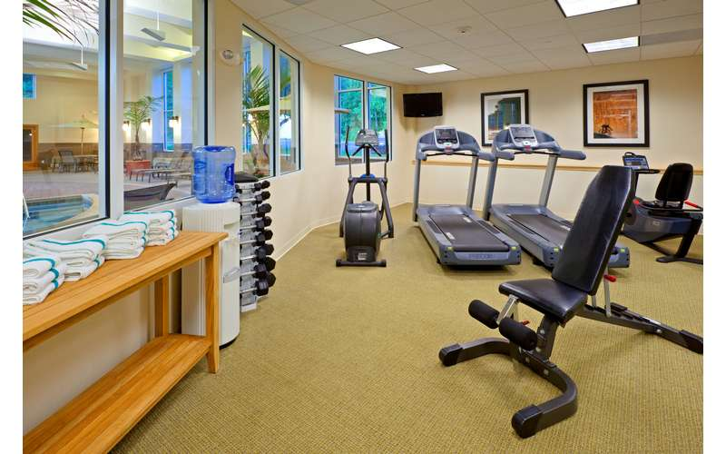 a fitness center with different machines like treadmills