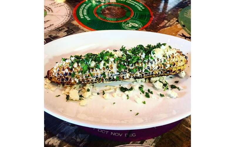 Grilled Mexican street -sweet corn, fresh crema, cotija cheese, cilantro