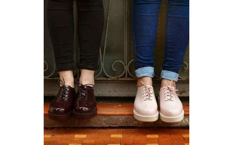 two women wearing different pairs of shoes