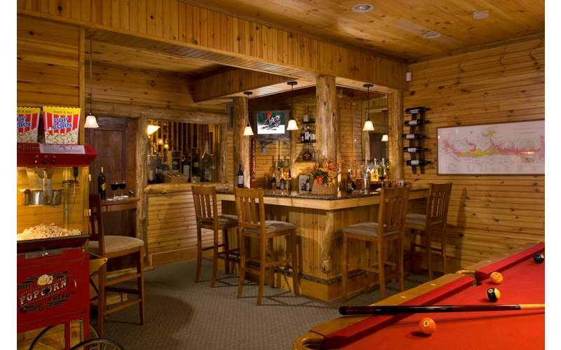 The help-yourself honor bar, pool table, sauna, theatre and exercise area room are for your enjoyment!