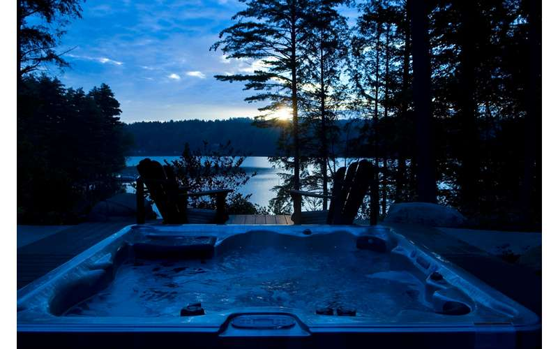 enjoy the under-the-stars hot tub overlooking the lake