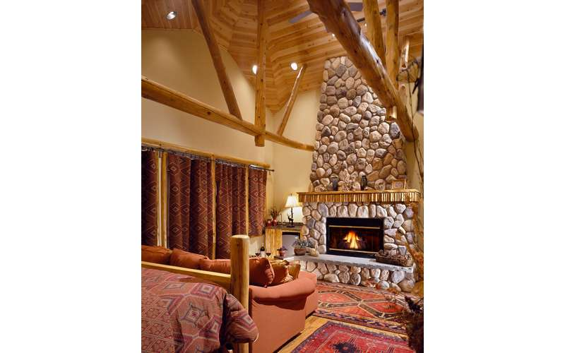 Our guest room &quote;Cedar at $450 features a fireplace, jacuzzi, tv, refrigerator/wet bar, and mountain view patio !
