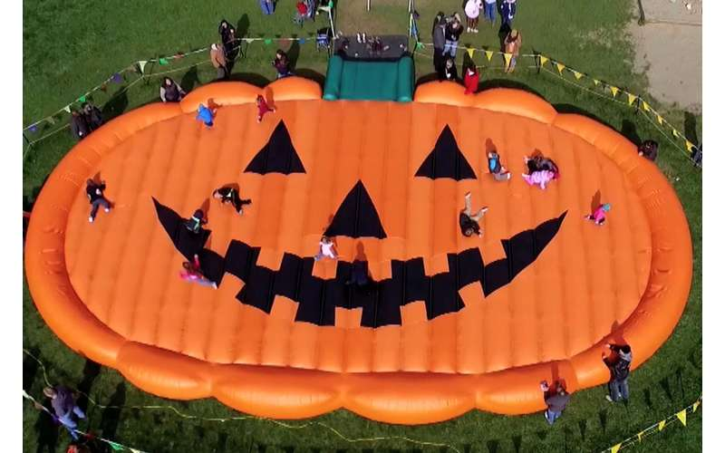 Celebrate Halloween and jump around on Ellms Family Farm's giant pumpkin pad.