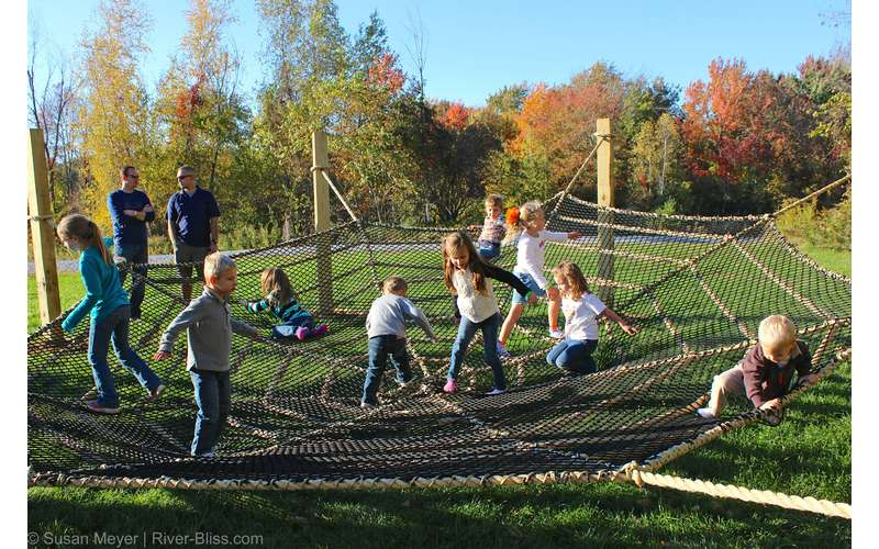 The spider web net at Ellms Family Farm is fun for young kids to bounce around.