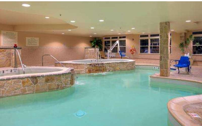 Indoor pool with 2 whirlpools and cascading waterfalls