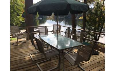 Sunset Point has a beautiful outdoor deck overlooking Loon Lake.