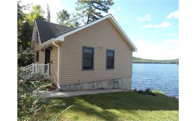 Summer's Delight on Brant Lake is a charming three bedroom rental house overlooking the water.