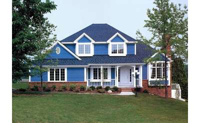a house with a vibrant shade of a blue with white trimmings and a well kept lawn