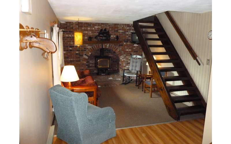 A downstairs fireplace in Cottage #8