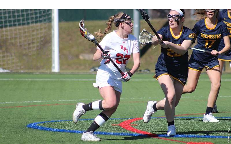 Female Player Looking to Pass the Lacrosse Ball