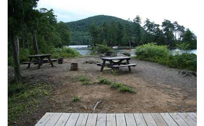 Campsite 1 is located on a wide open peninsula, which is one of our favorite spots.Be warned there is little cover so it could get very windy. For sun lovers it's a perfect spot with an expansive campsite and a fire pit overlooking Glen Island. This campsite has a platform