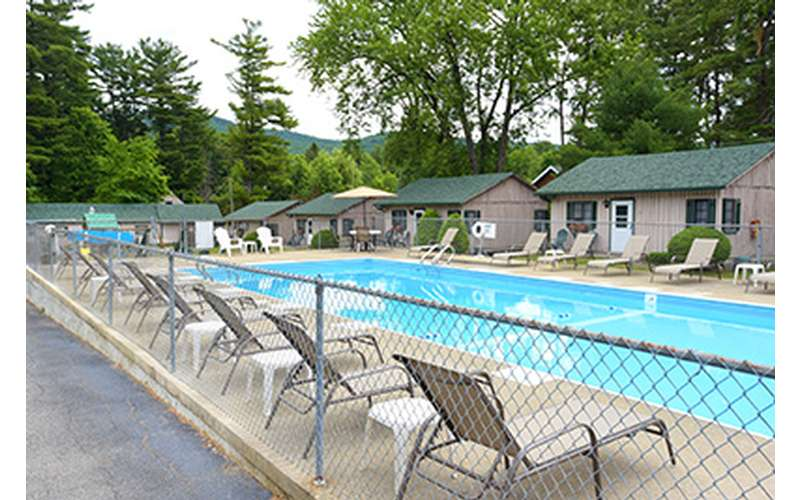 Enjoy the Lake George sunny weather by the pool.