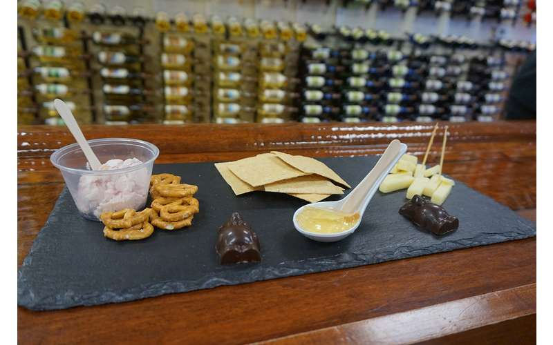 Enjoy a locavore slate plate alongside your tasting featuring locally made cheeses, chocolates, crackers and more!