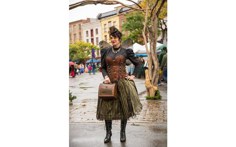 a woman in a fairy/steampunk outfit