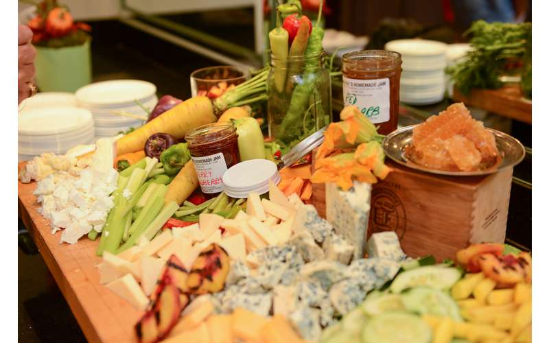 fresh veggies and cheese displayed on a table