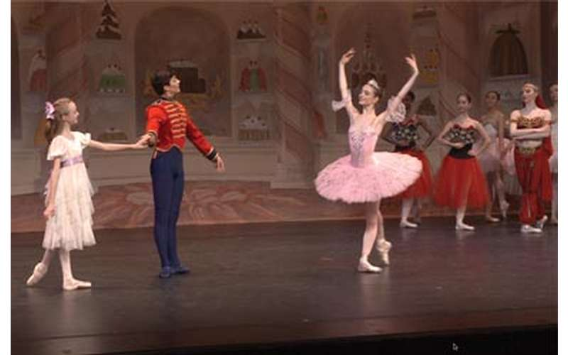 Ballerina and other dancers on stage