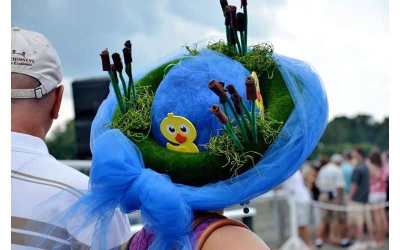 blue hat with fake duck and grass on it