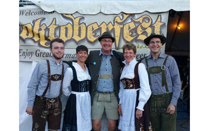 people dressed in oktoberfest outfits