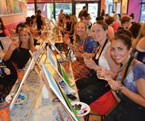 women at paint and sip