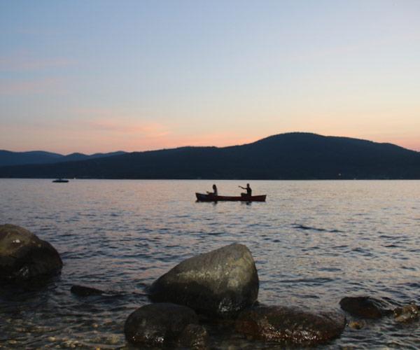 people canoeing on lake george