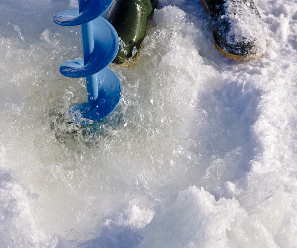 testing ice thickness with an auger
