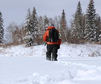 person hiking in winter