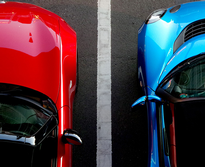 red and blue cars in parking lot