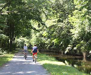 boys riding bikes on feeder canal trail