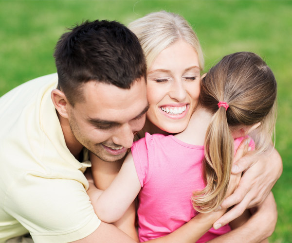 child hugging her parents