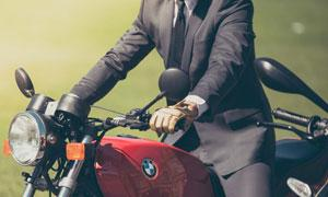 man in suit on a motorcycle
