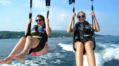 girls parasailing over lake george