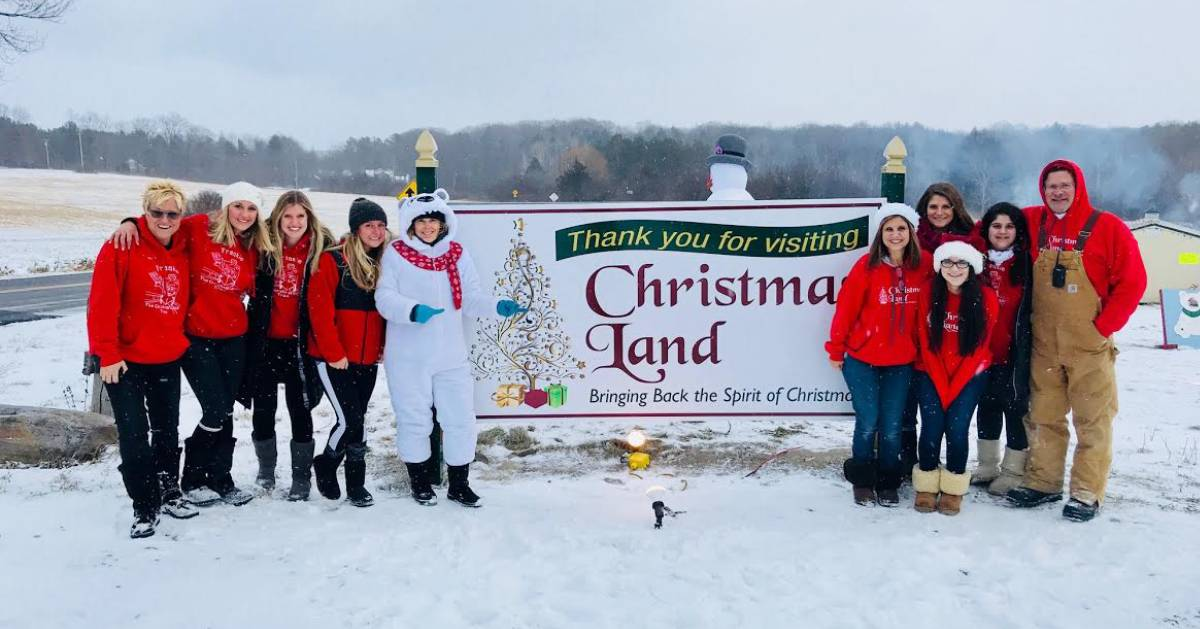 christmas land sign and people