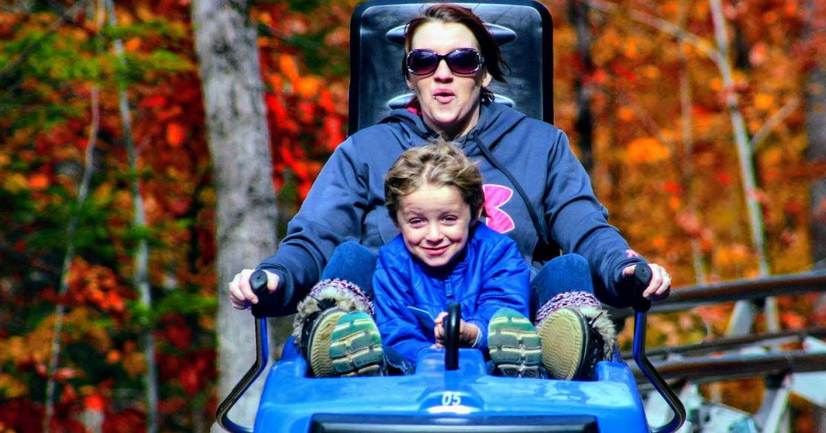 parent and kid on coaster