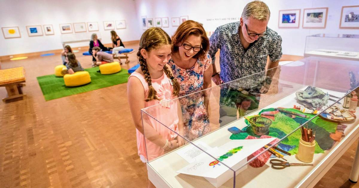 kid with her parents at Eric Carle Museum