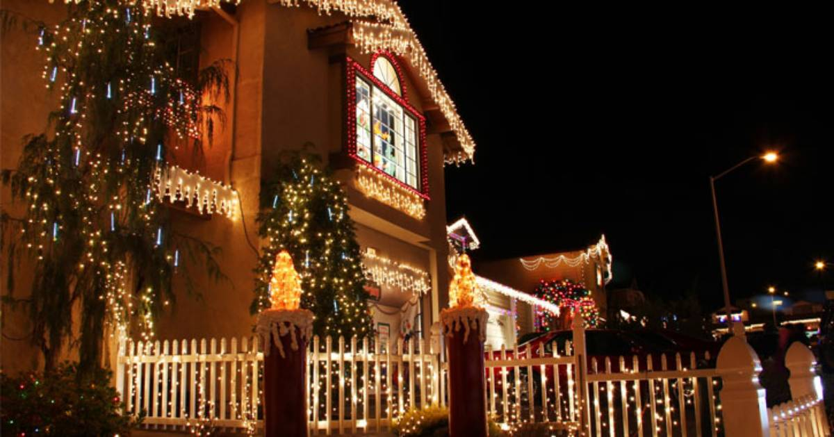 house with christmas lights outside it