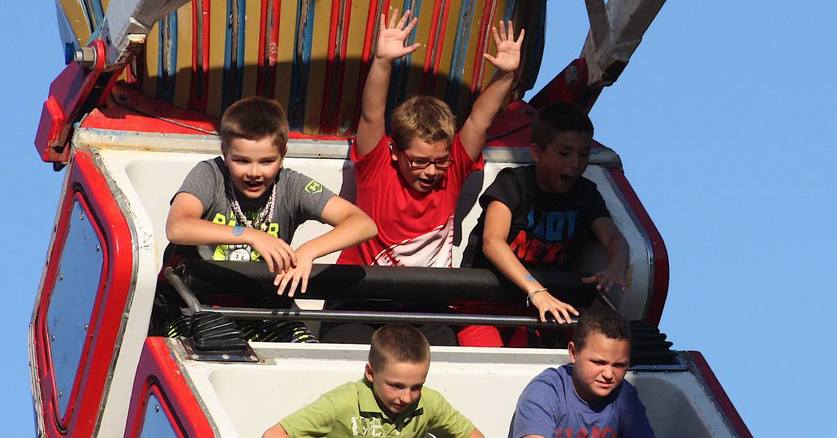 kids on a swing ride at the fair