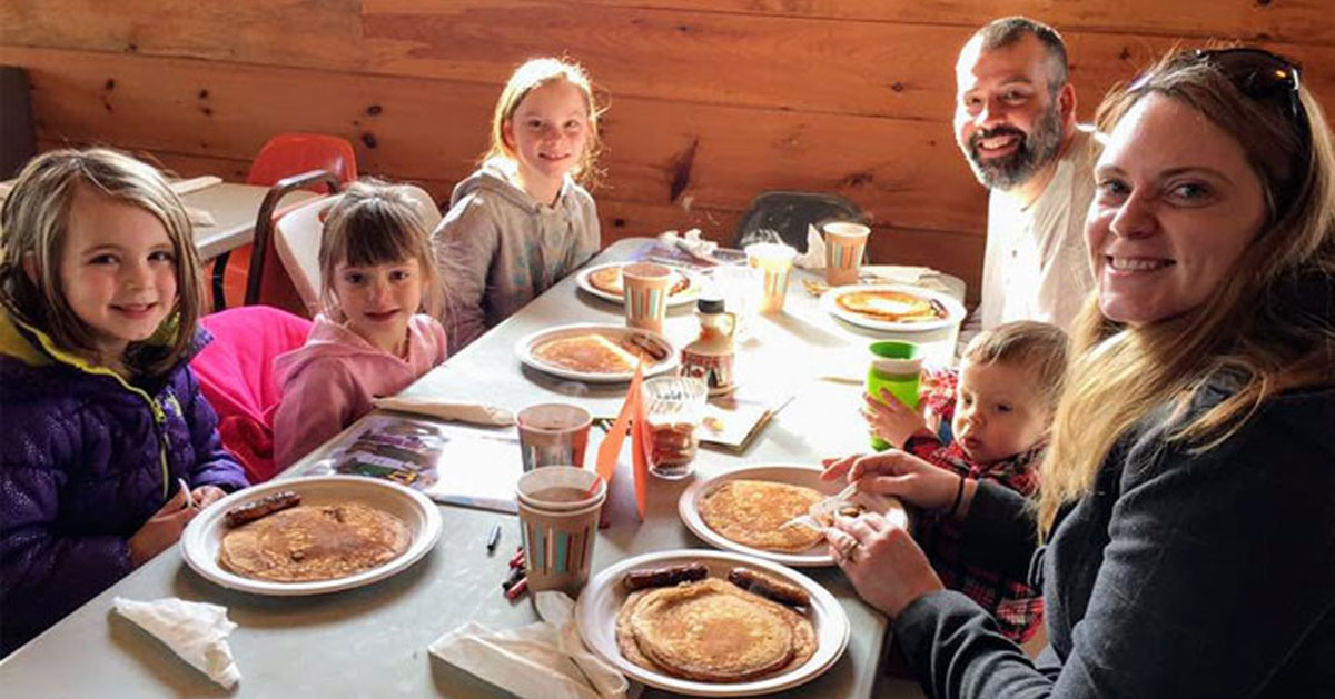 family enjoying pancake breakfast
