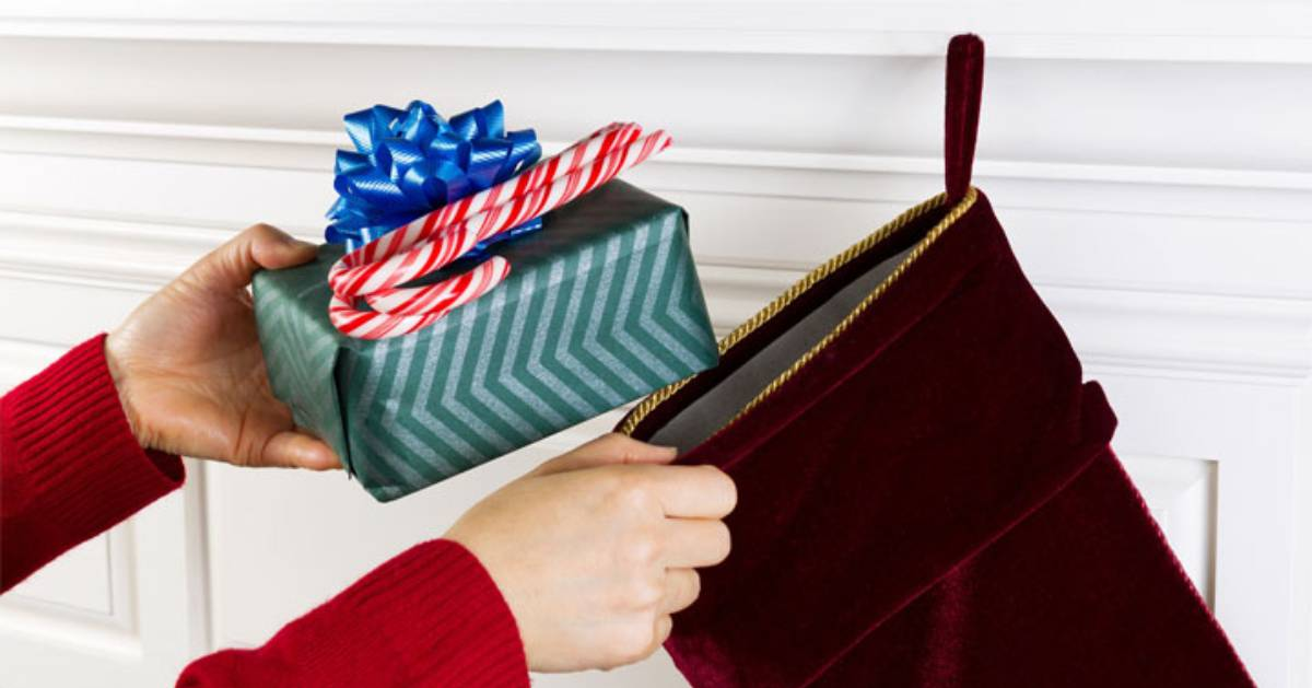 putting gifts into a stocking