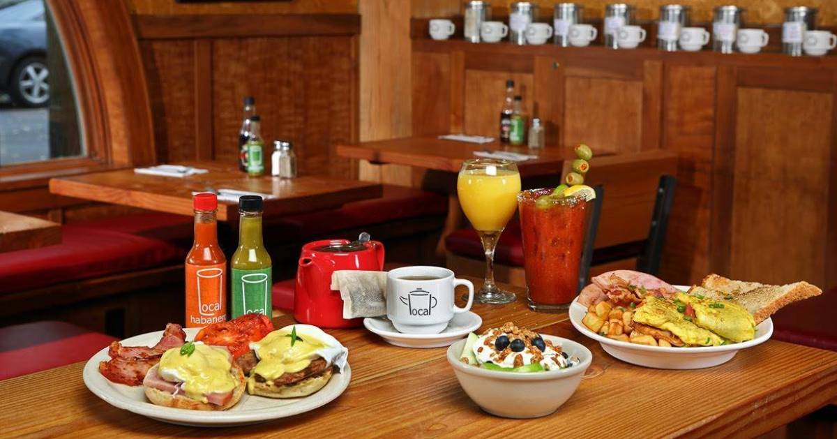 bloody mary and food on table