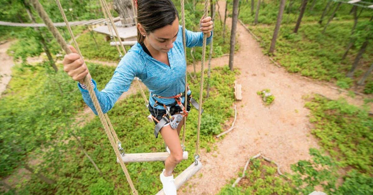 girl on treetop course
