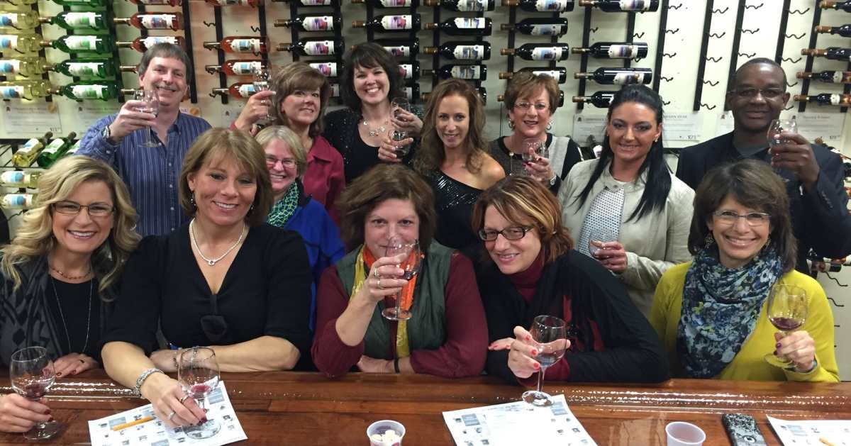 large group of people at a winery tasting
