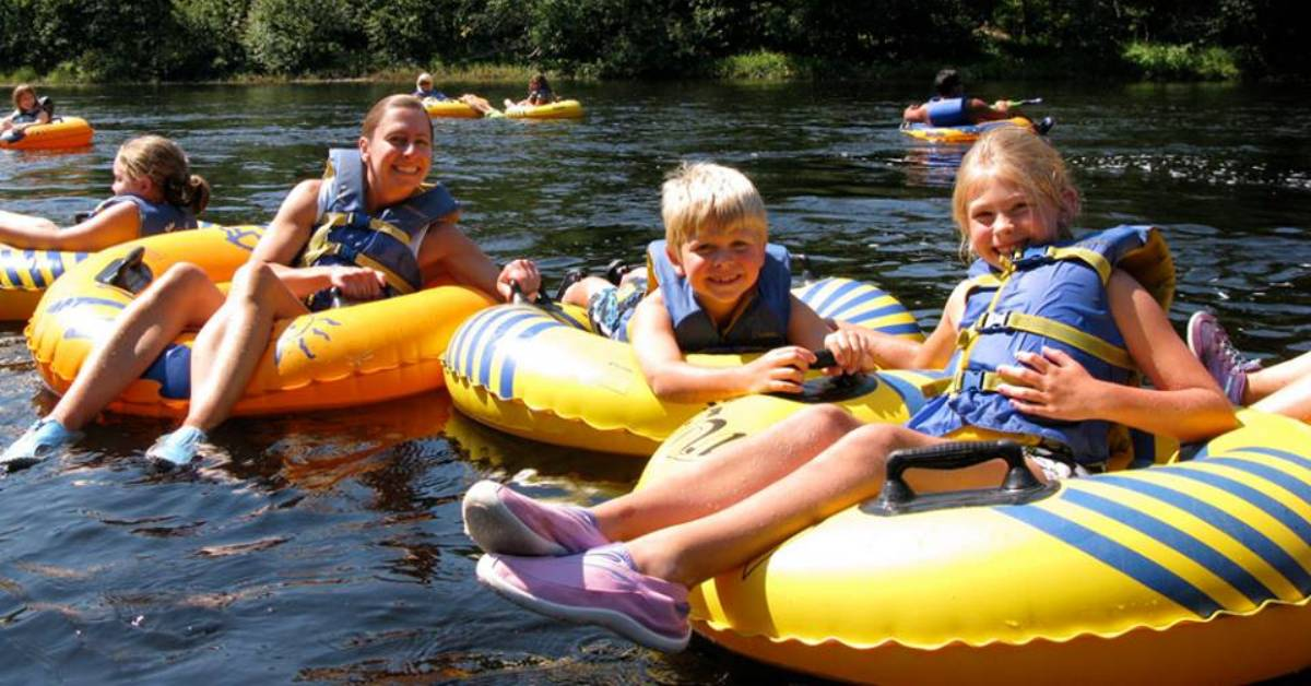 kids and adult woman lazy river tubing