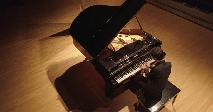 man plays piano