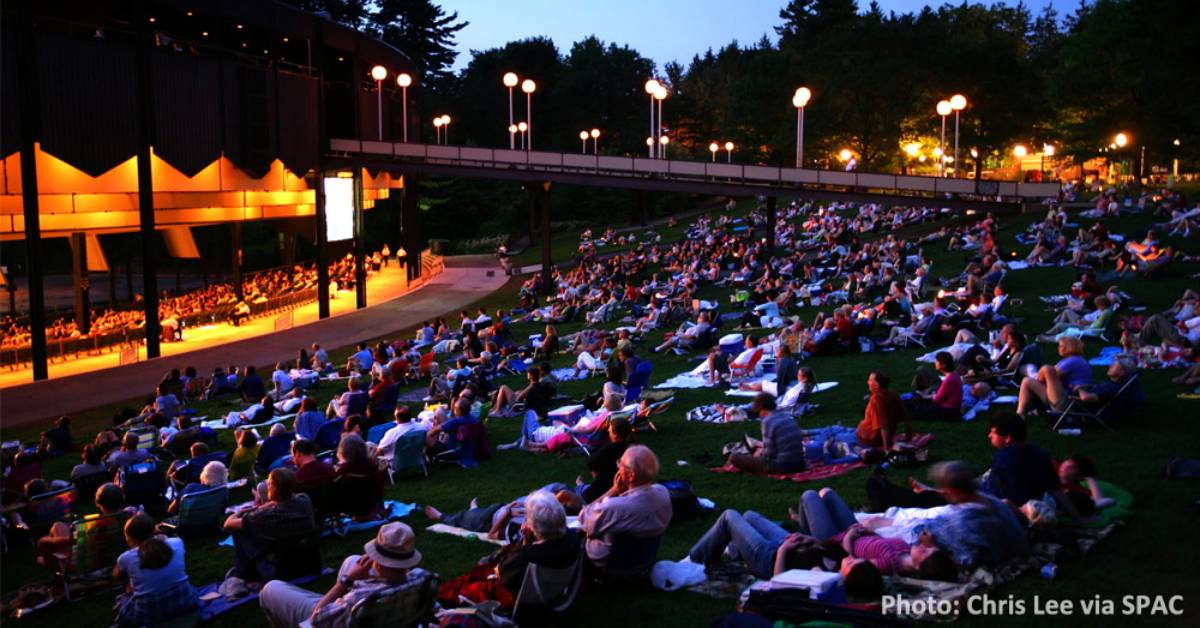 people on lawn at amphitheater