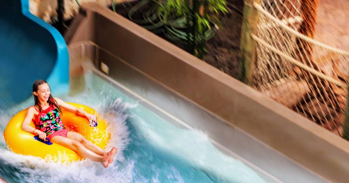 girl on tube in water park