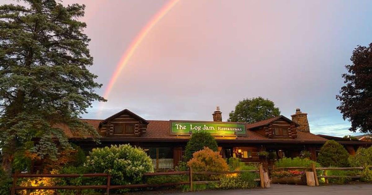 Log Jam Restaurant and rainbow in sky