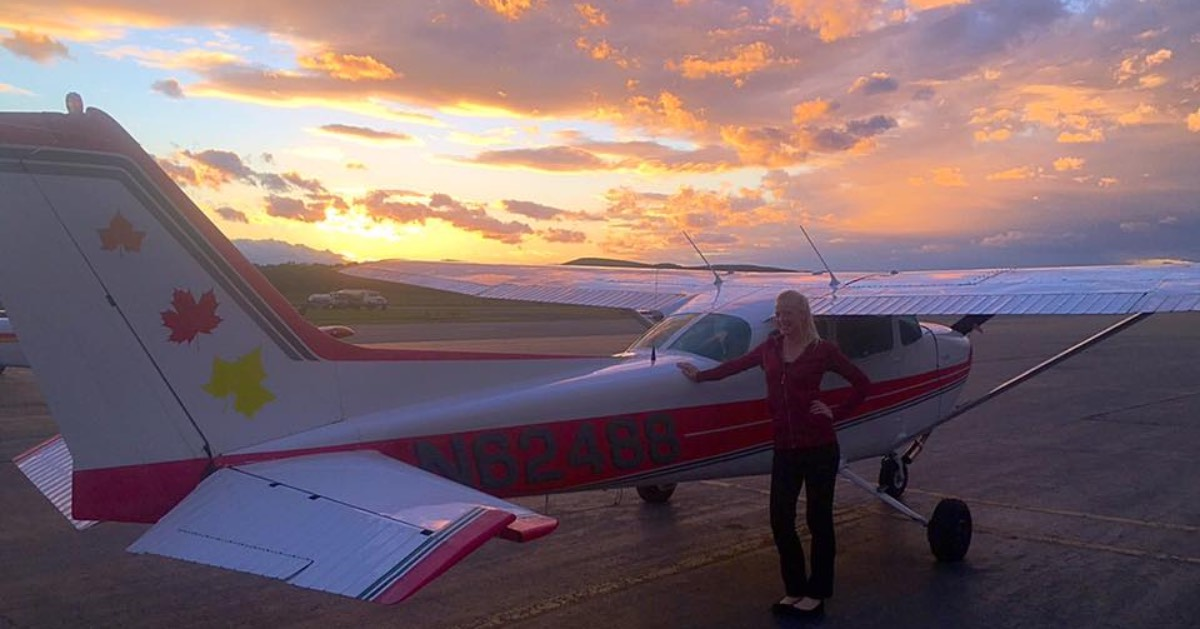 a pilot, small plane and sunset view
