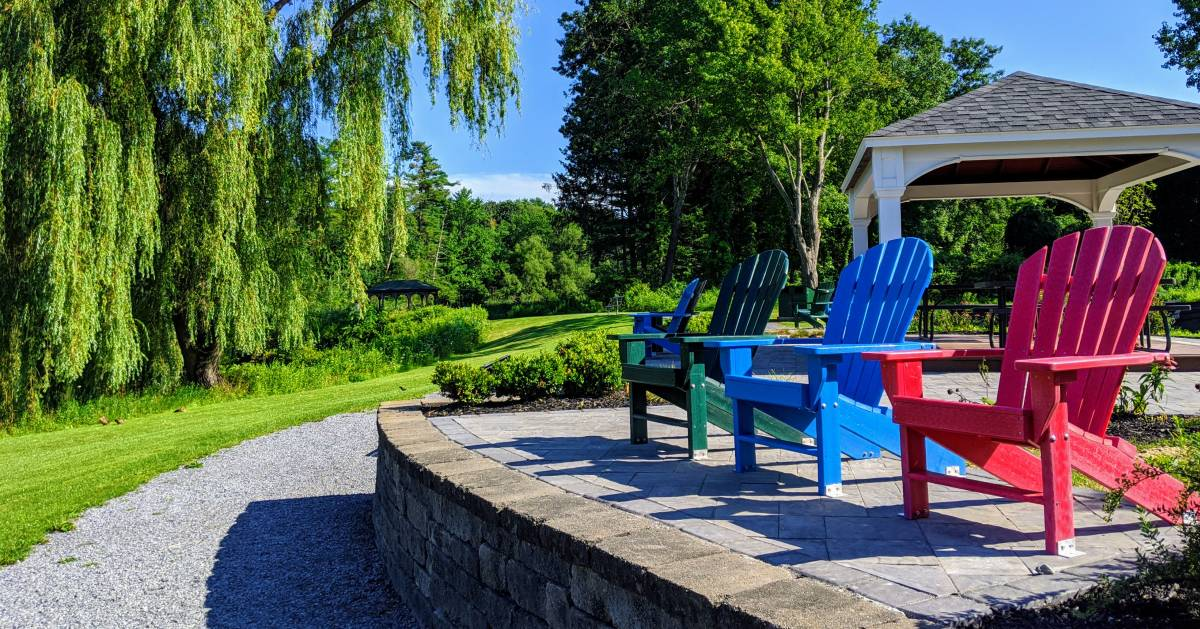colorful Adirondack chairs in a park