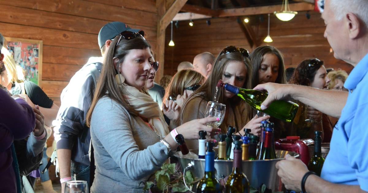 people at an indoor wine tasting