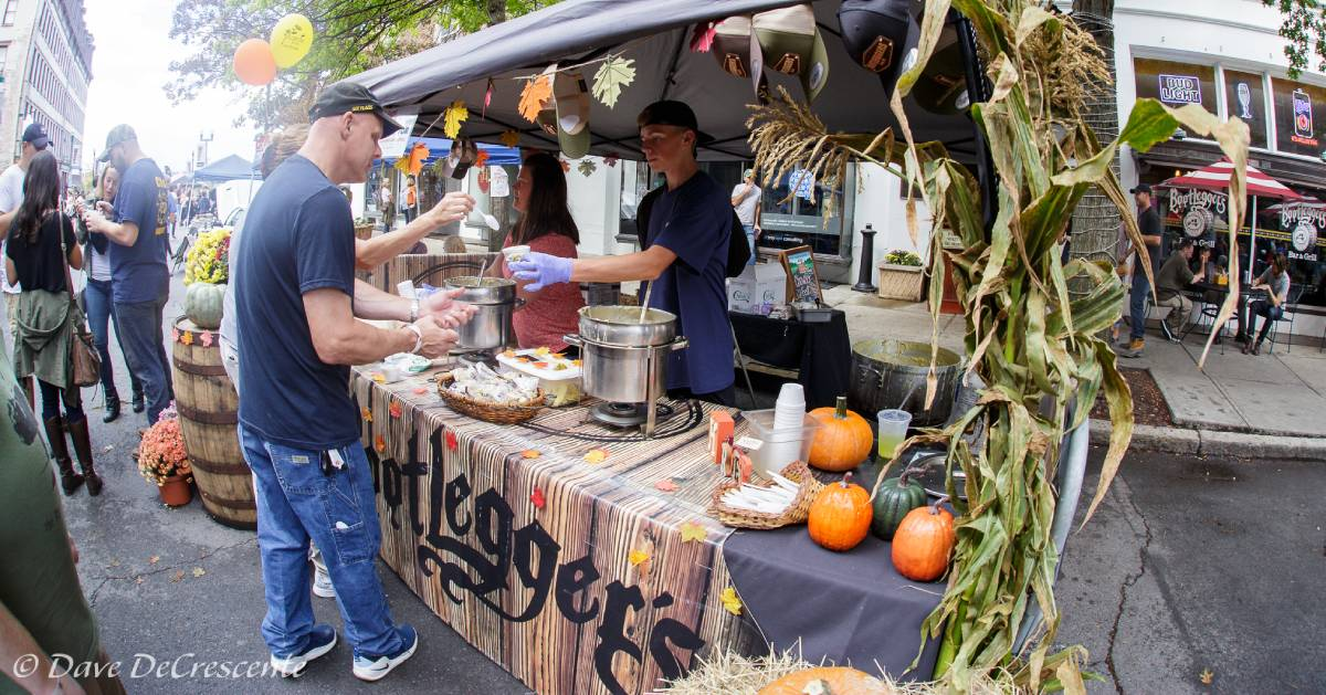man at an outdoor chowder tasting station